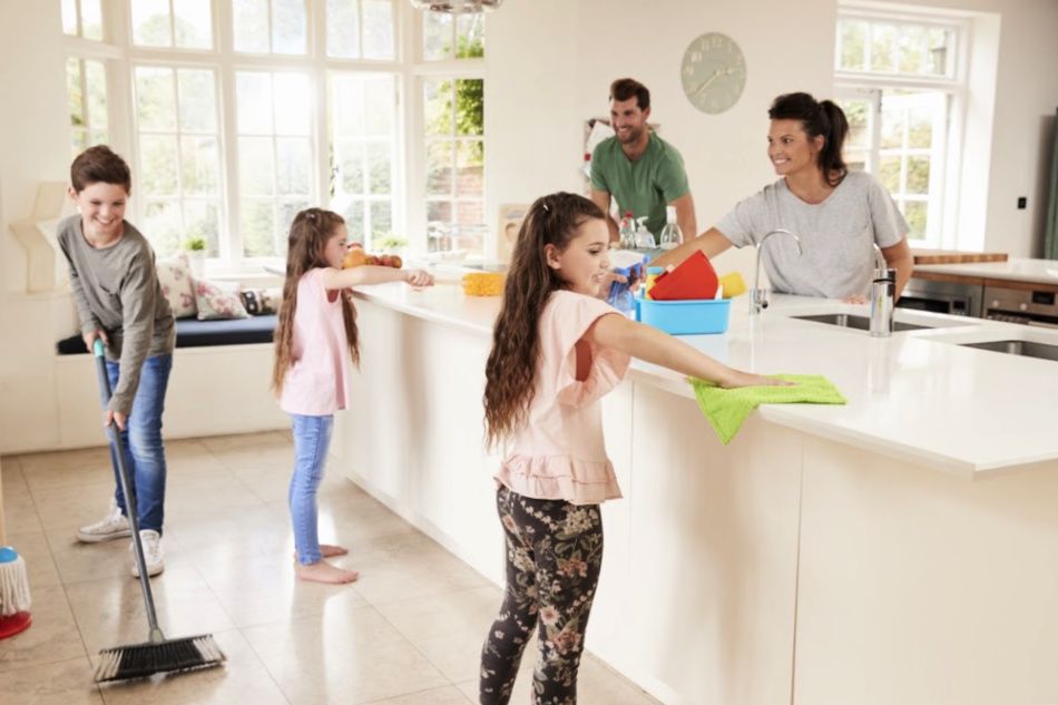Children Helping Parents With Household Chores In Kitchen